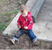 Picture of a kid playing with soil.